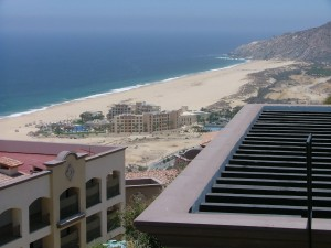 View of Pacifica Hotel down the beach from Sunset Beach Balcony